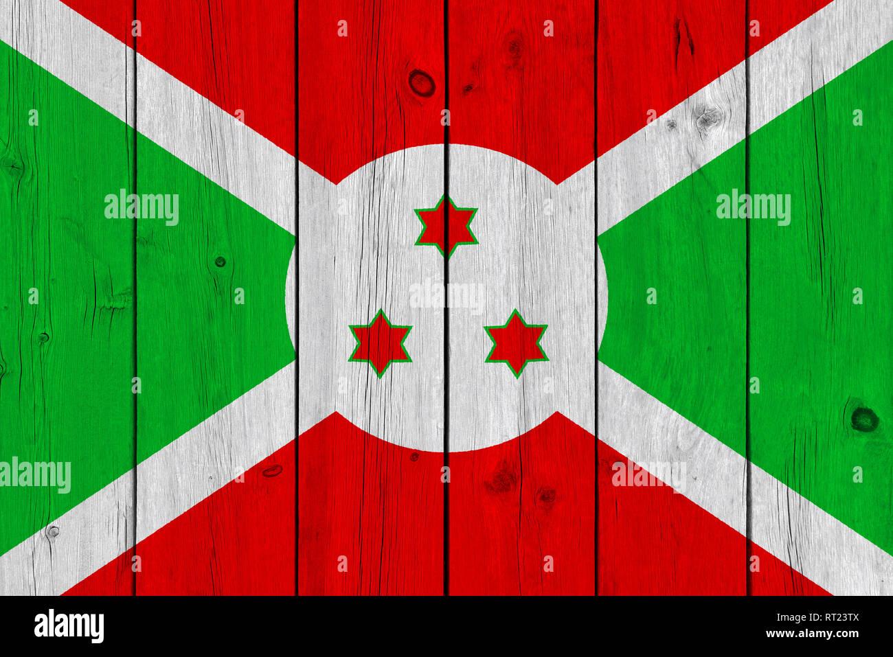 Burundi flag painted on old wood plank. Patriotic background. National flag of Burundi Stock Photo