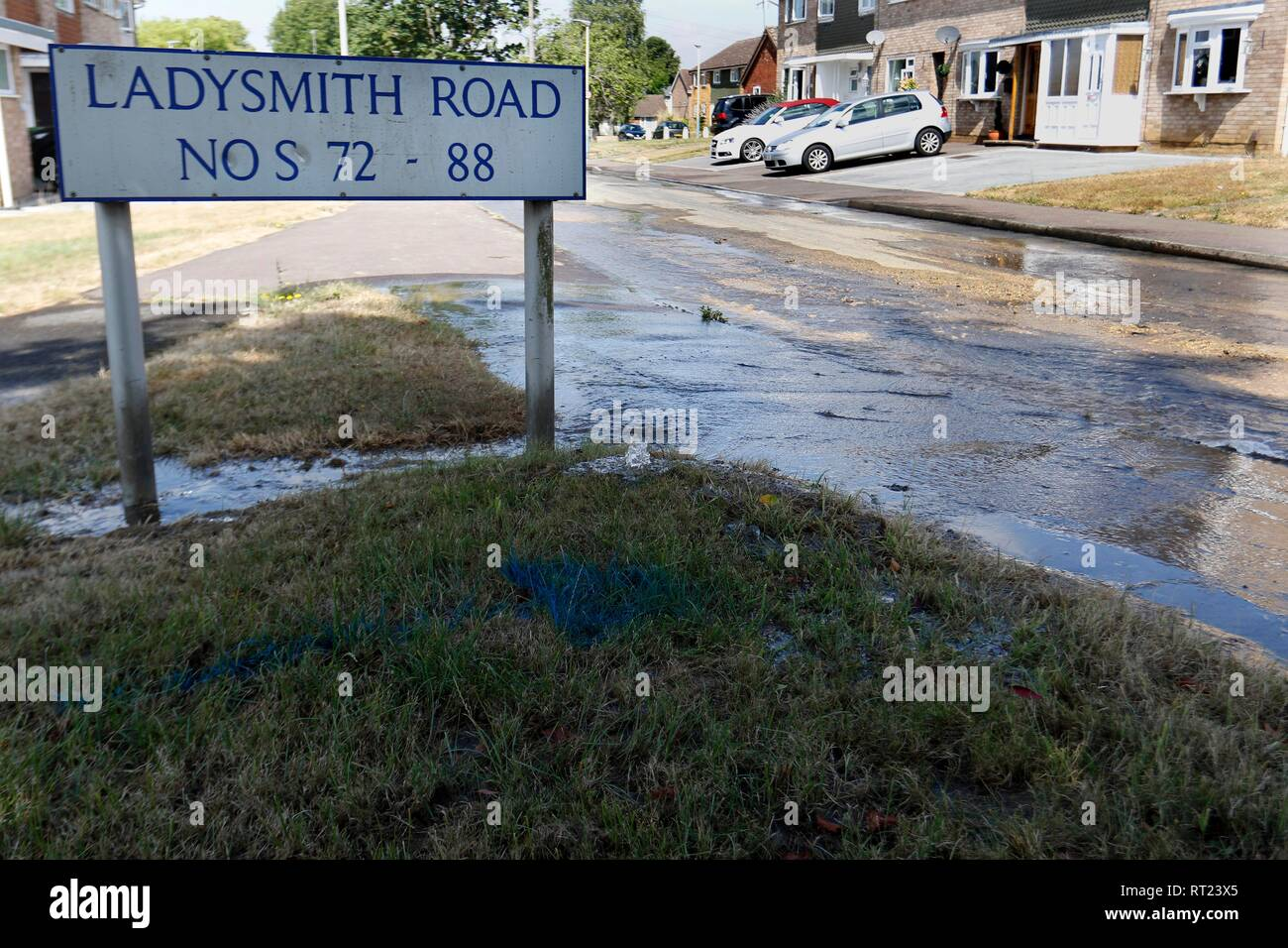 A new water leak flooding the road on Ladysmith Road, Cheltenham. 23rd July 2018 - Stock Image