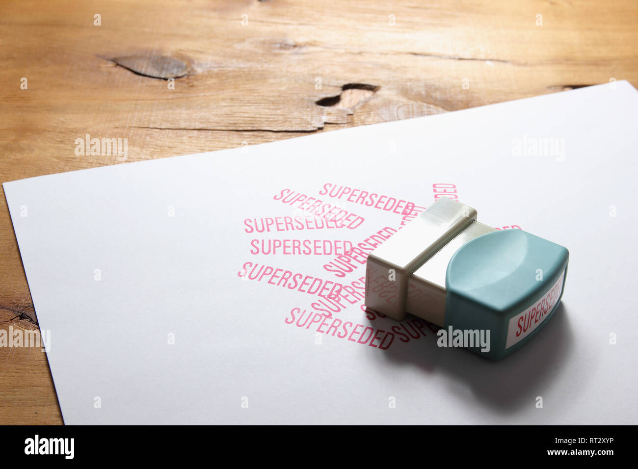 Rubber Stamp on Wooden Background - Stock Image