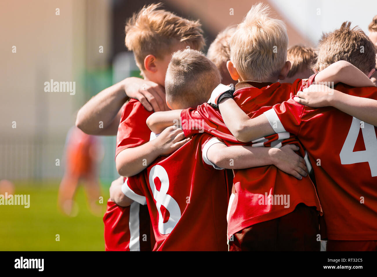 Kids Play Sports Game. Children Sporty Team United Ready to Play Game. Children Team Sport. Youth Sports For Children. Boys in Sports Jersey Red Shirt - Stock Image