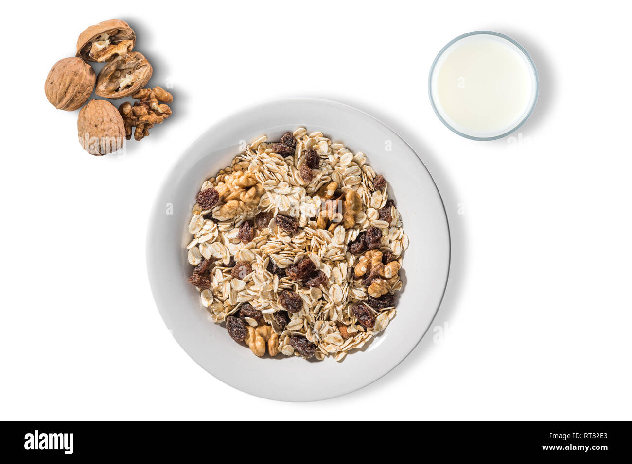 white plate with oat flakes on white background Stock Photo
