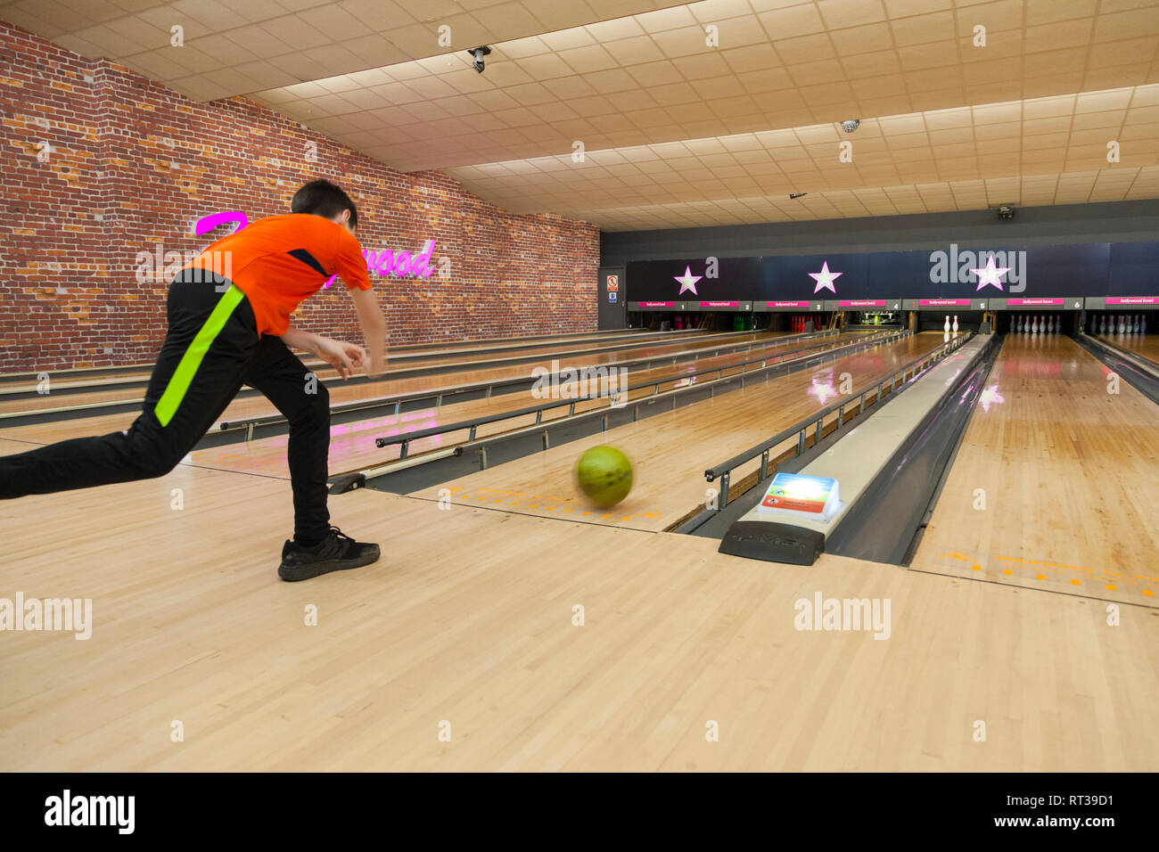 12 year old teenager boy bowling, hollywood bowl, ashford, kent, uk - Stock Image