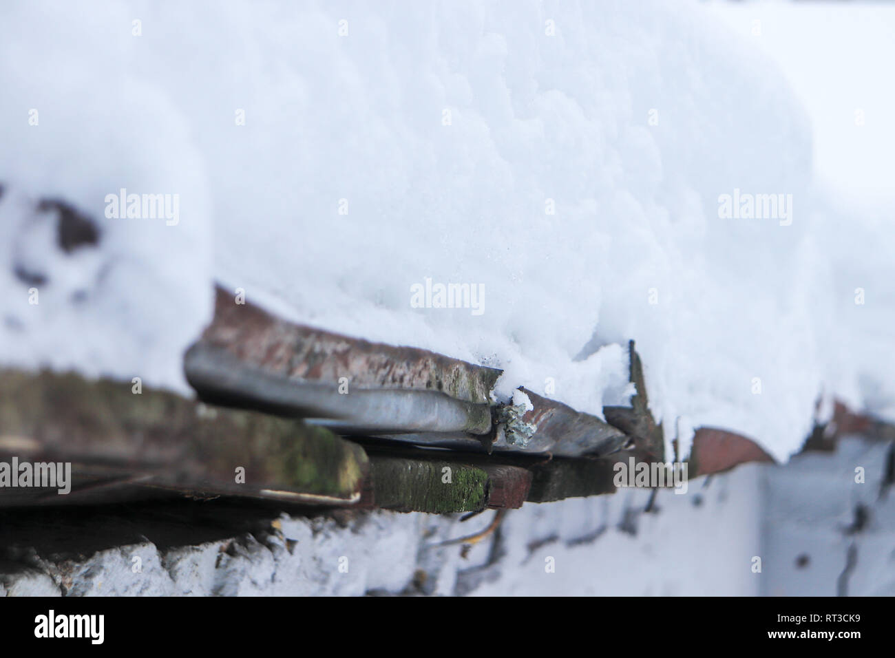 Wooden with galvanized metal roof under the snow - Stock Image