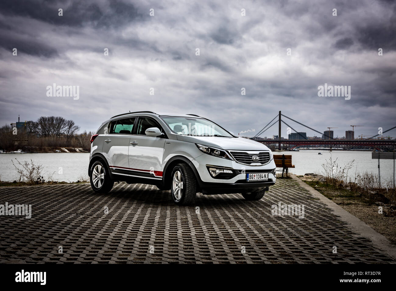 SUV Kia Sportage 2.0 CRDI awd or 4x4, white color, parked on the banks of the river Sava, on the stormy weather with gloomy clouds. Stock Photo