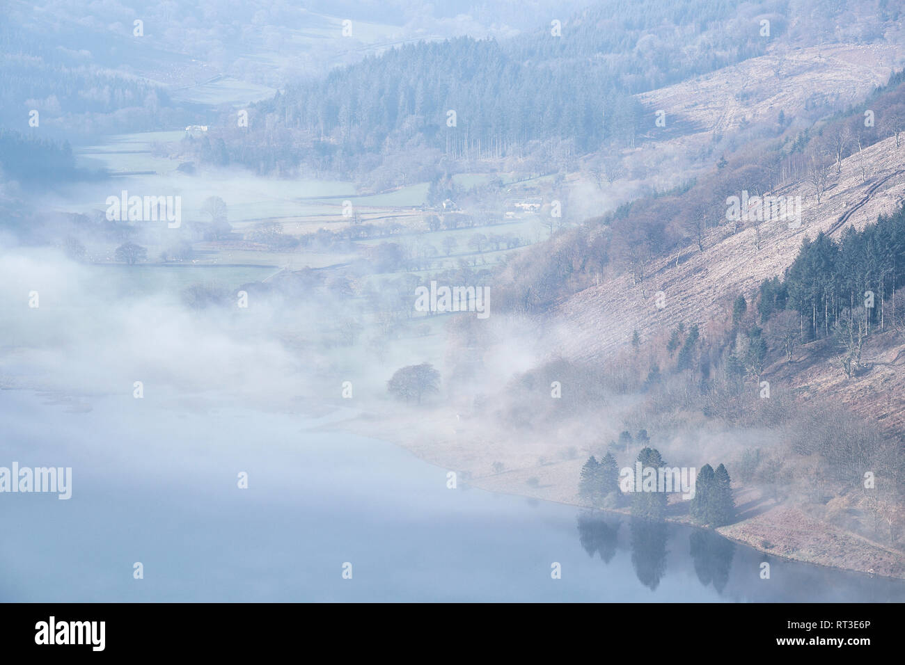 Low cloud over the Talybont Reservoir and surrounding countryside on a February morning, The Brecon Beacons National Park, Wales, UK - Stock Image