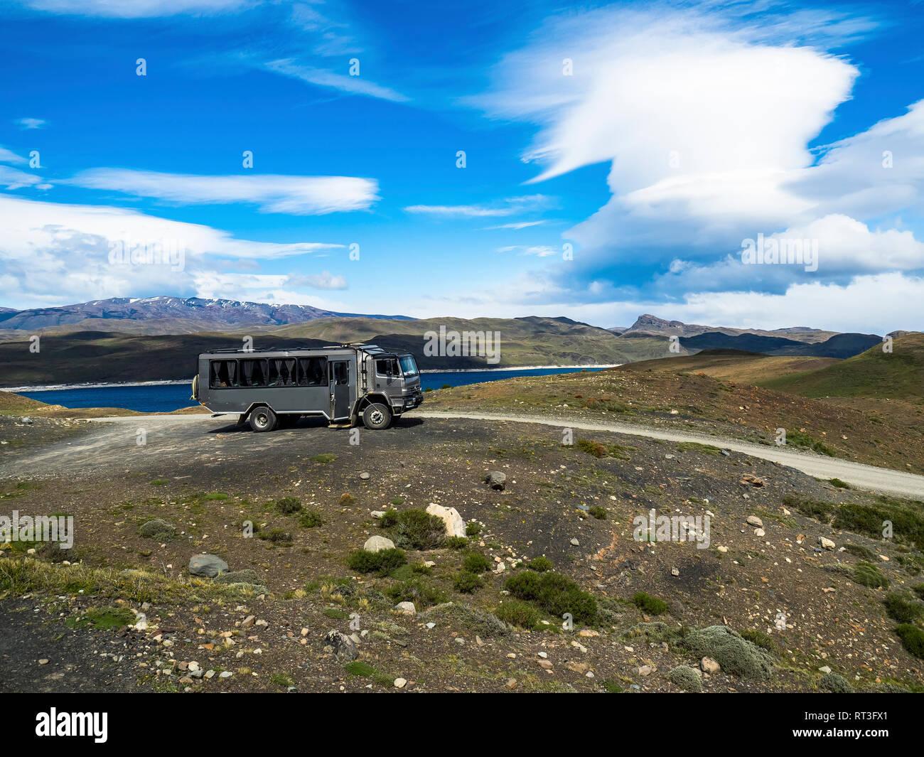 Chile, Patagonia, Torres del Paine National Park, Cerro Paine Grande and  Torres del Paine, Lago Nordenskjold, bus - Stock Image