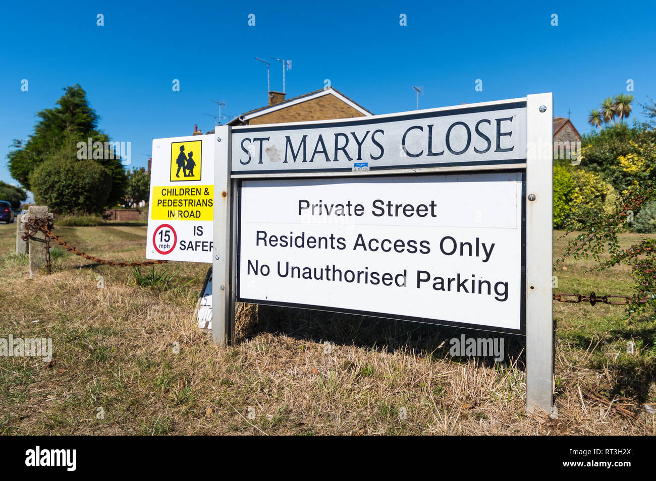 British road name sign fixed in the ground for a close, for a private road with residents access only and no unauthorised parking, in England, UK. - Stock Image
