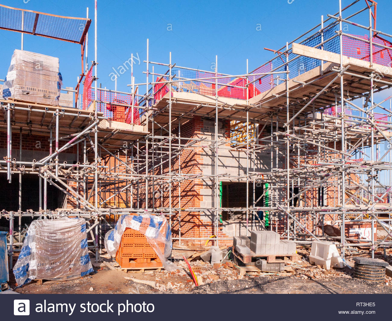 New homes in scaffolding and under construction in Cheshire England UK - Stock Image