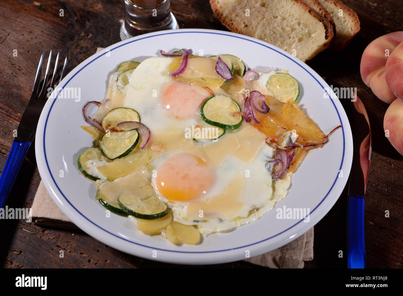 fried egg dish with zucchini and potatoes - Stock Image