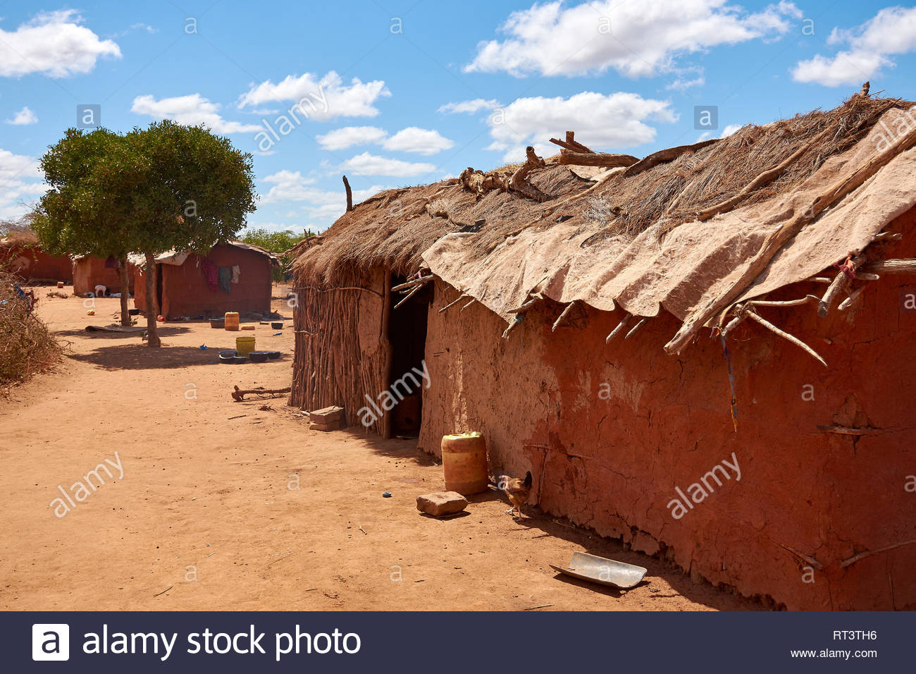 View of an old masai village with huts of clay. Poverty and misery in Kenya in Africa - Stock Image