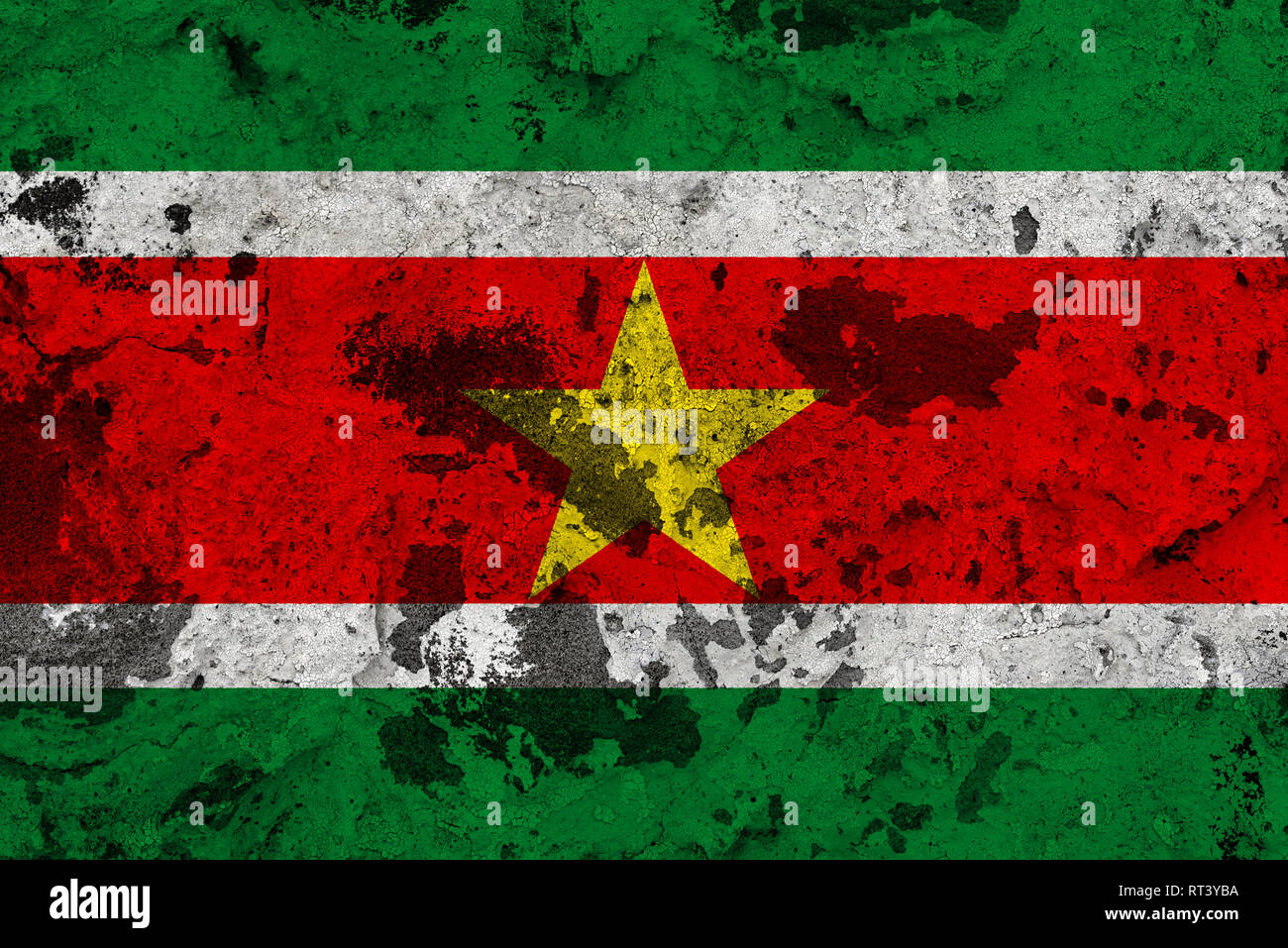 Suriname flag on old wall. Patriotic grunge background. National flag of Suriname - Stock Image