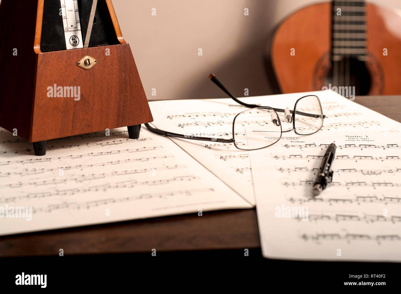 Study music and metronome with guitar in background - Stock Image