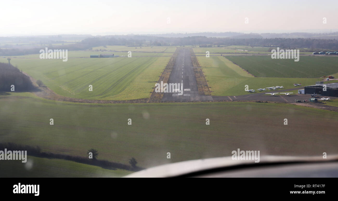aerial cockpit view coming into land at Tatenhill Airfield near Derby in a Cessna 152 light aircraft - Stock Image