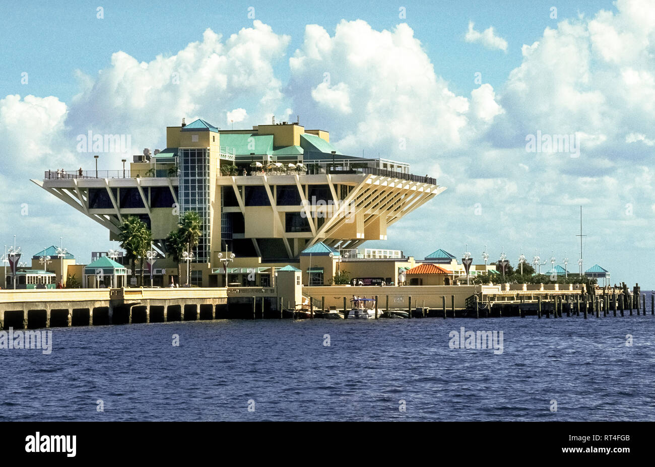 This is an historical photograph of The St. Petersburg Pier, a landmark pleasure pier extending into Tampa Bay from downtown St. Petersburg on the Gulf Coast of Florida, USA. With its novel architectural design of an inverted pyramid, The Pier opened in 1973 but was demolished in 2015 after deteriorating over the years. Construction began soon after on a new $76 million-dollar Pier Park that extends 3,065 feet (934 meters) into the bay and ends with a contemporary four-story Pier Head building featuring a restaurant, gift and bait shop, café and rooftop bar. - Stock Image