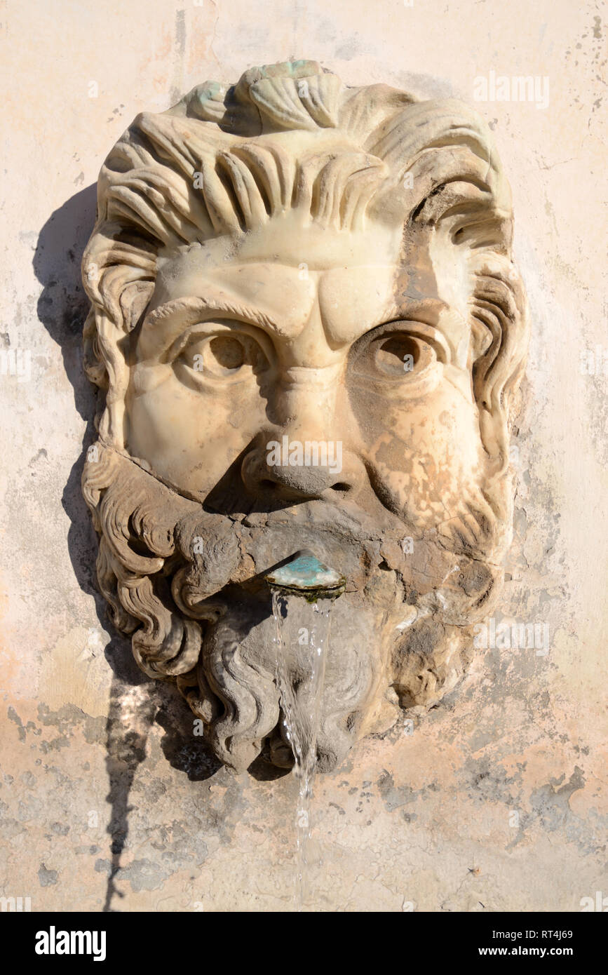 Bearded Face or Man's Face on Wall Fountain in Pigna Courtyard of the Cortile del Belvedere or Belvedere Palace Vatican Museums - Stock Image