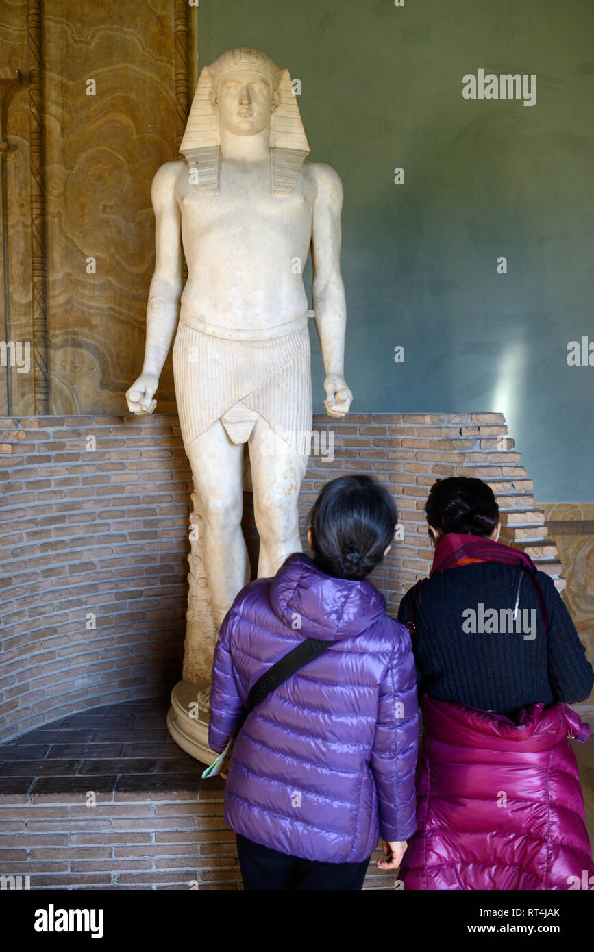 Two Tourists Admire Statue of Antinous (c111-130AD), Bithynian Greek Youth & Favourite of Roman Emperor Hadrian, Egyptian Museum Vatican Museums - Stock Image