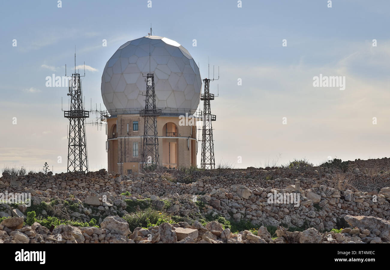 View on the Radar Station 'il Ballun' near the Dingli Cliffs in Malta on a clear sunny day. Stonewalls in the foreground. - Stock Image