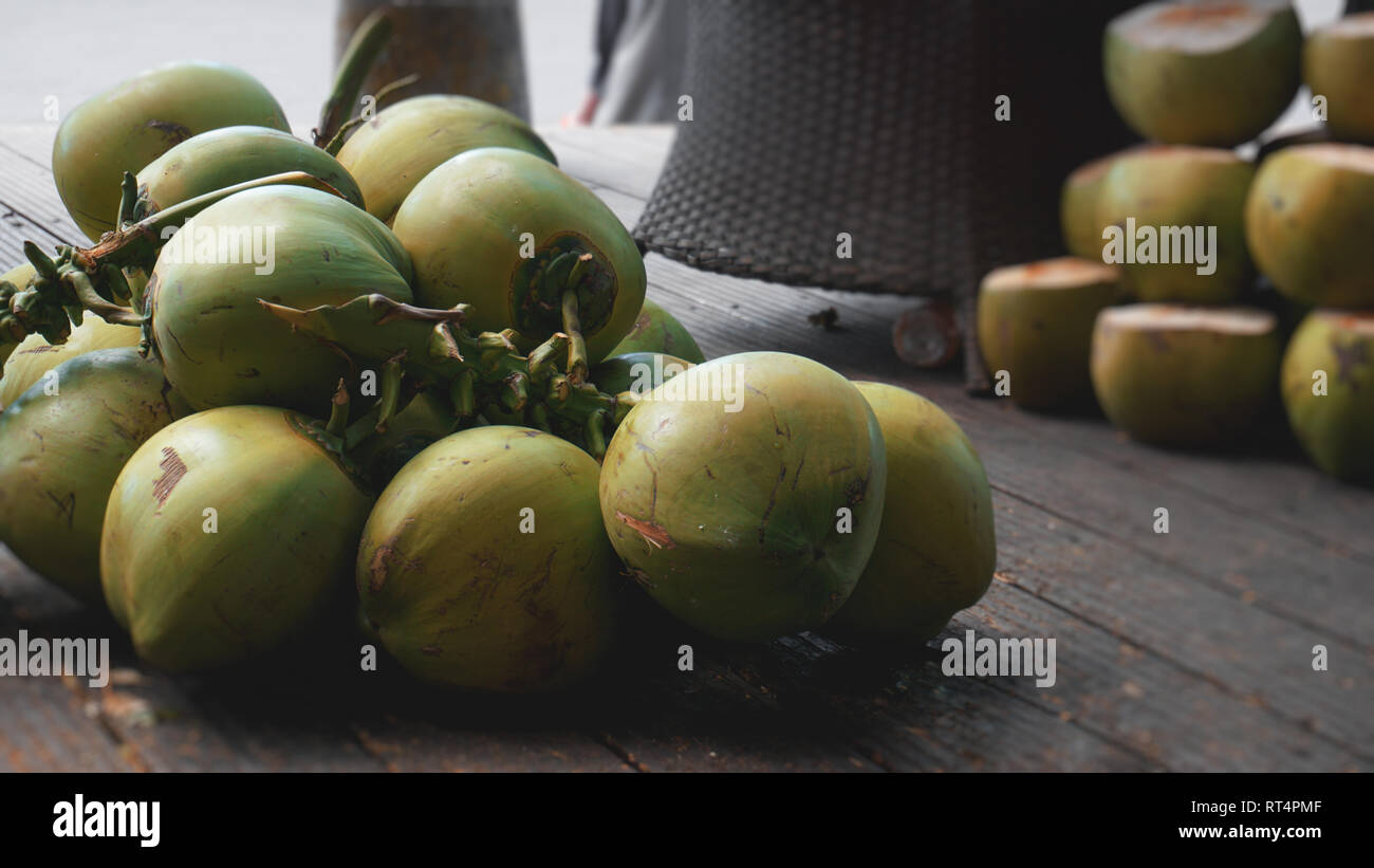 Sweet green coconuts. Coconut tropical fruit for drink in China Stock Photo