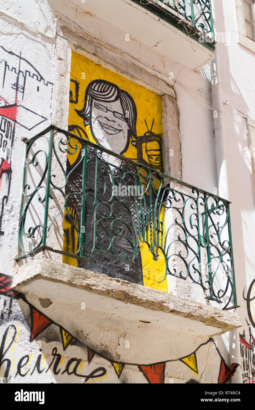 Graffiti and street art in a street of lisbon portugal stock image