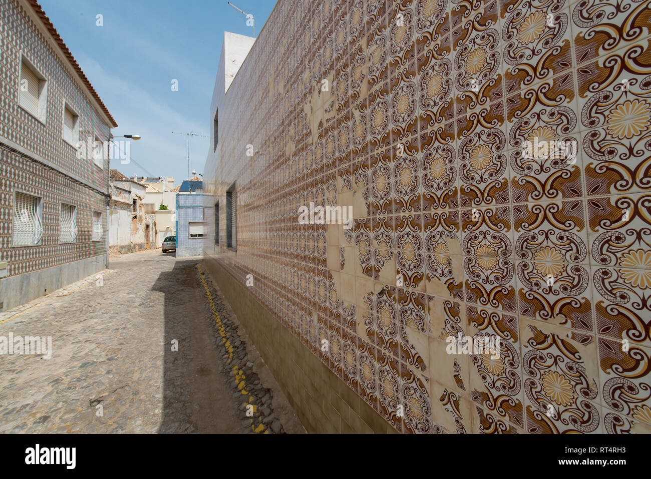 Azulejos Portuguese exterior wall tiles in Tavira, Portugal. Traditional decorative azulejos wall ceramic tiles - Stock Image