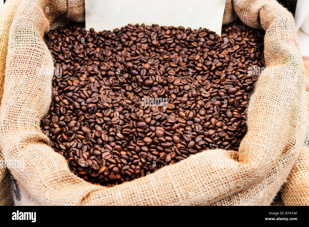 Roasted coffee beans in a bag - Stock Image