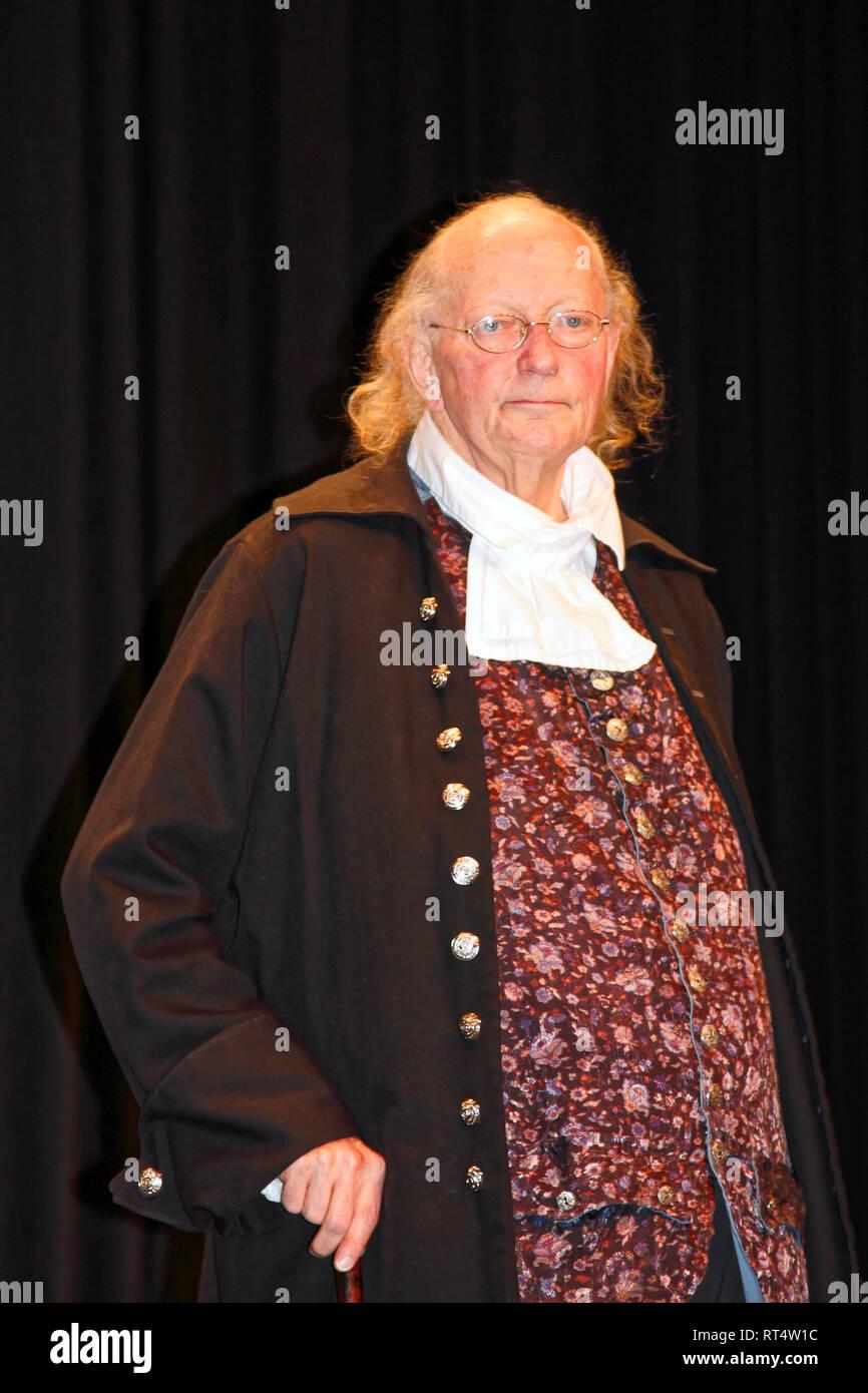 Ben Franklin impersonator; historical interpreter; colonial costume; look alike, important United States figure, statesman, winter; vertical - Stock Image