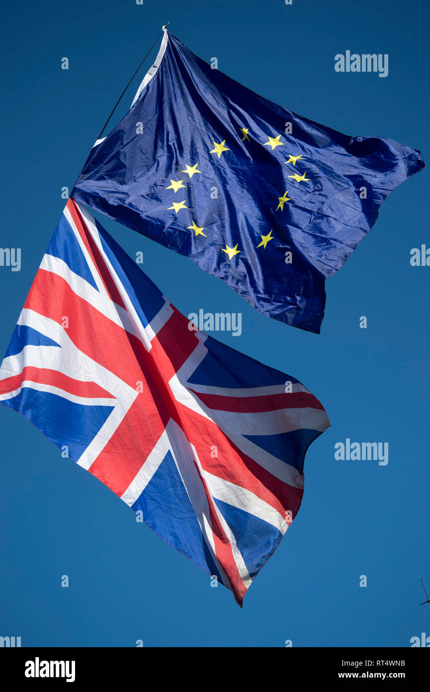 Westminster, February 26th 2019. A Remainer waves a Union Jack and European flag - Stock Image