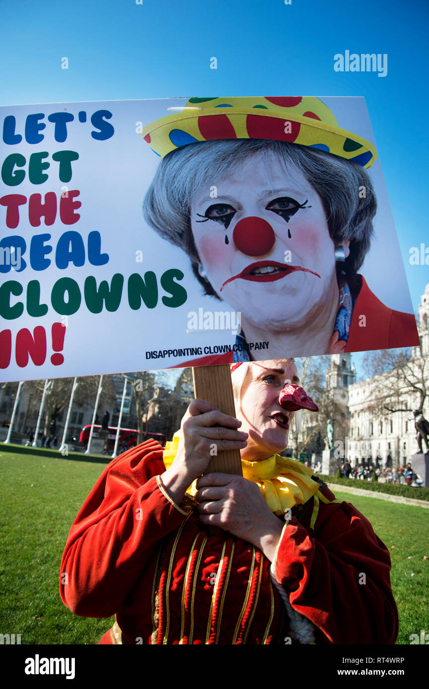 Westminster, February 26th 2019. Mr Punch (Professor Queen Bee) protests in front of Parliament against the misuse of the word 'clowns' by the media w - Stock Image