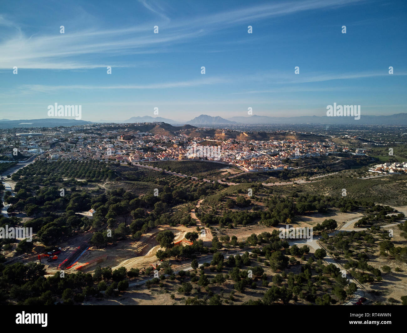Aerial drone point of view photography countryside and Quesada district in the municipality of Rojales. Sunny day wide high angle landscape. Province  - Stock Image
