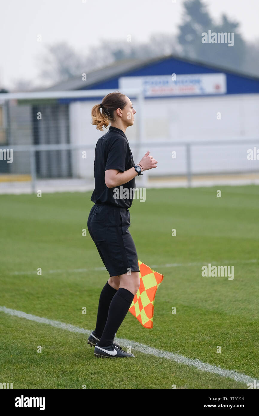 Female Assistant Referee at Football game. - Stock Image