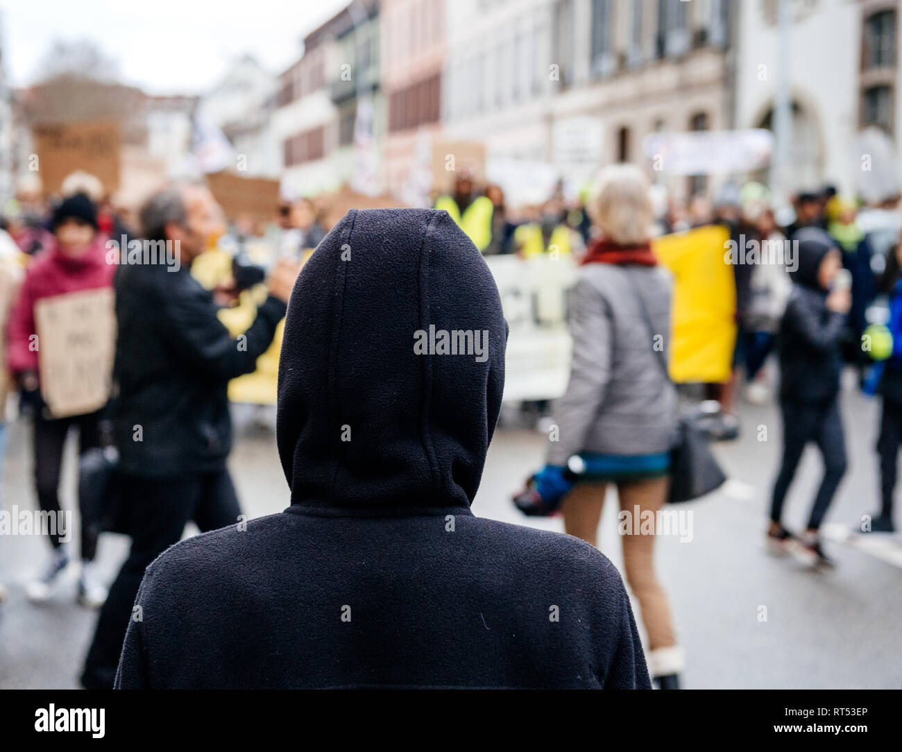 Silhouette looking at crowd marching in Central Strasbourg at the nationwide protest Marche Pour Le Climat - Stock Image