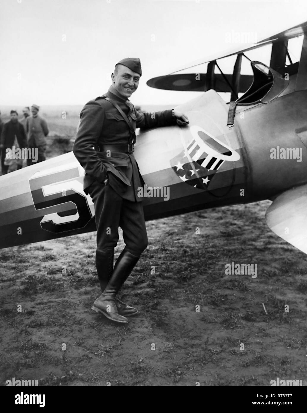 Full-body portrait of American Air Ace Eddie Rickenbacker aside his SPAD XIII aircraft. - Stock Image