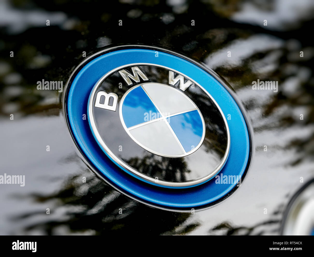 STRASBOURG, FRANCE - MAY 30, 2017: Side view of blue BMW logotype on the electric i1 limousine  - Stock Image