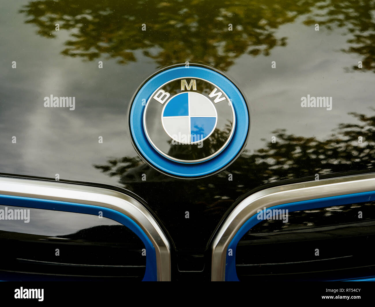 STRASBOURG, FRANCE - MAY 30, 2017: Front above view of blue BMW logotype on the electric i1 limousine  - Stock Image