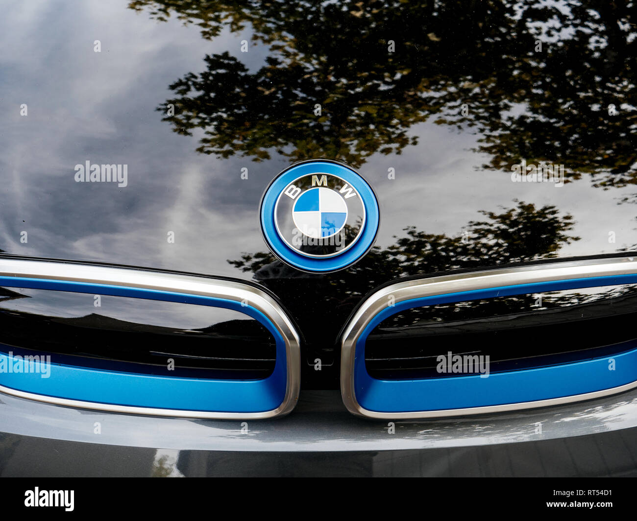 STRASBOURG, FRANCE - MAY 30, 2017: Front view of blue BMW logotype on the electric i1 limousine  - Stock Image