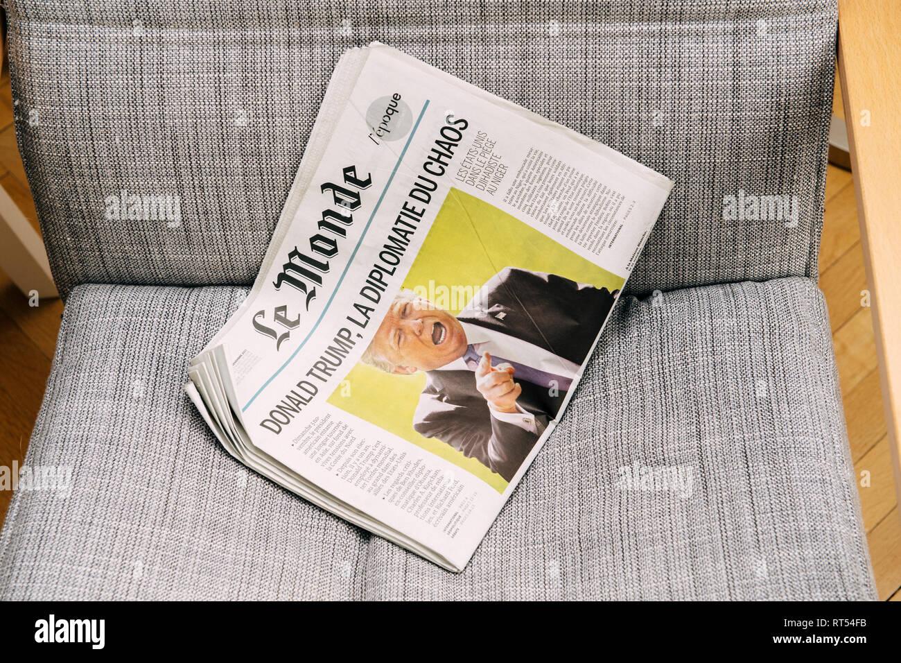 PARIS, FRANCE - NOV 6, 2017: Armchair background latest Le Monde newspaper featuring headline Donald Trump is Chaos Diplomacy - Stock Image