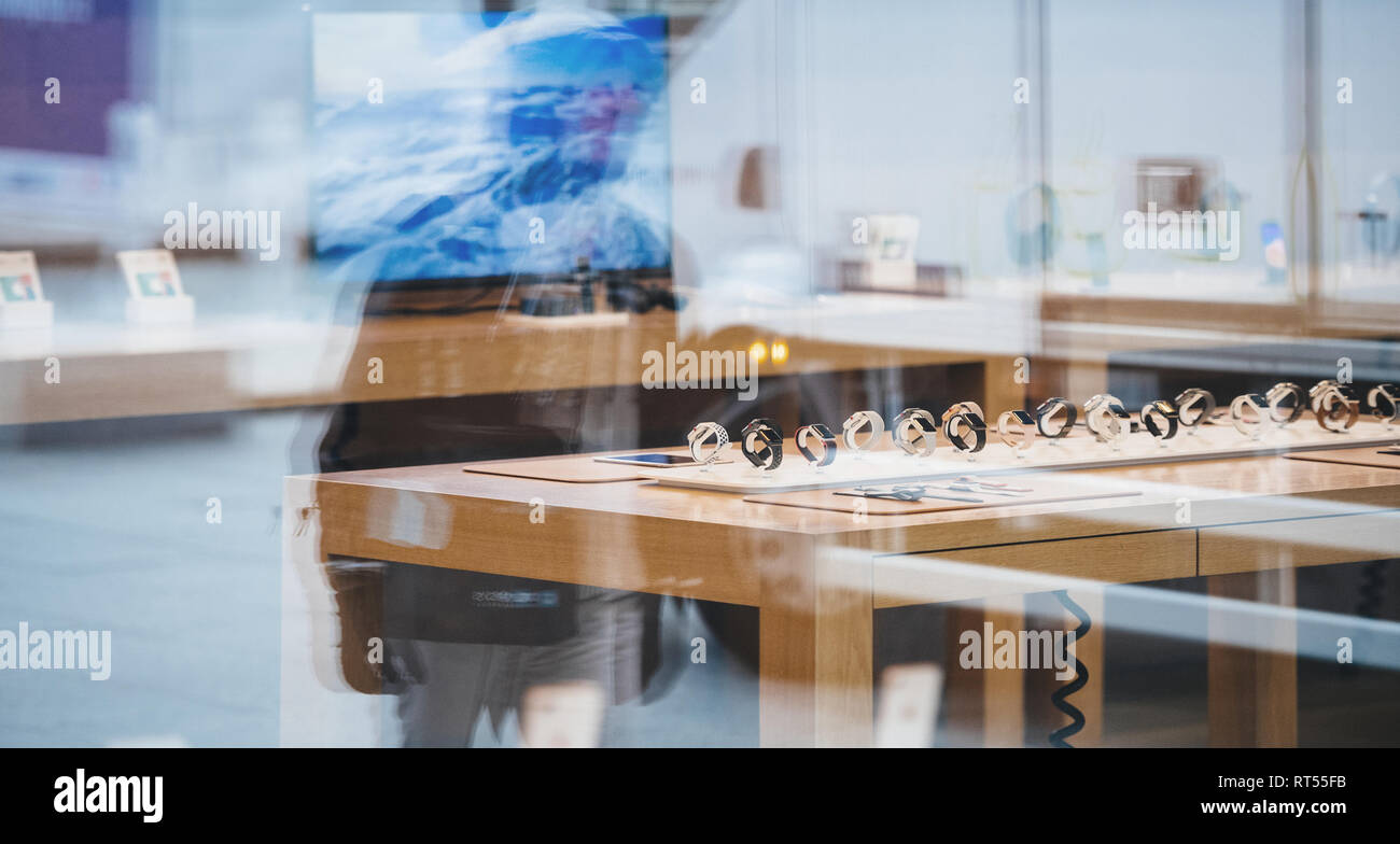 STRASBOURG, FRANCE - NOV 3, 2017: City reflection of Apple Store with Apple Watch Series 3 range waiting for the customers  Stock Photo