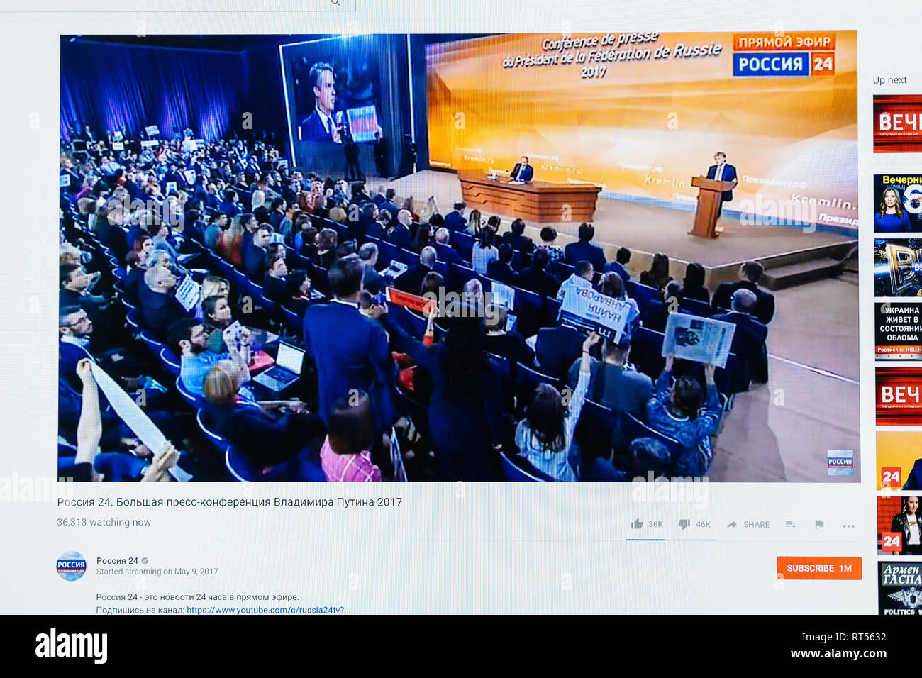 PARIS, FRANCE - DEC 14, 2017: POV watching on Youtube live channel of Rossiya RTR the Russian President Vladimir Putin give final media Q&A before March election - journalists in hall  - Stock Image
