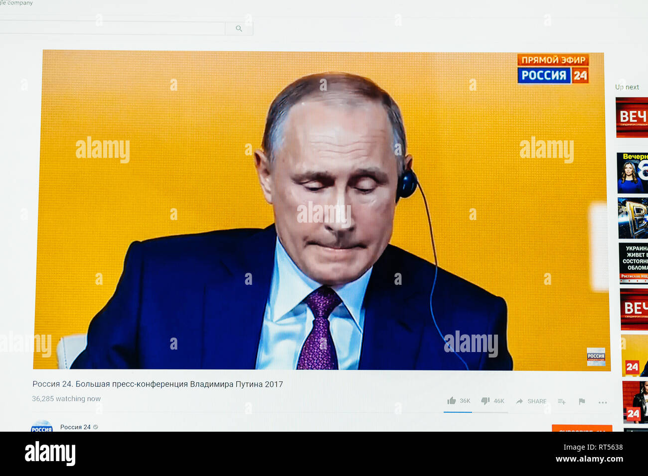 PARIS, FRANCE - DEC 14, 2017: Youtube live channel of Rossiya RTR the Russian President Vladimir Putin give final media Q&A before March election - listening to foreign journalists translation - Stock Image