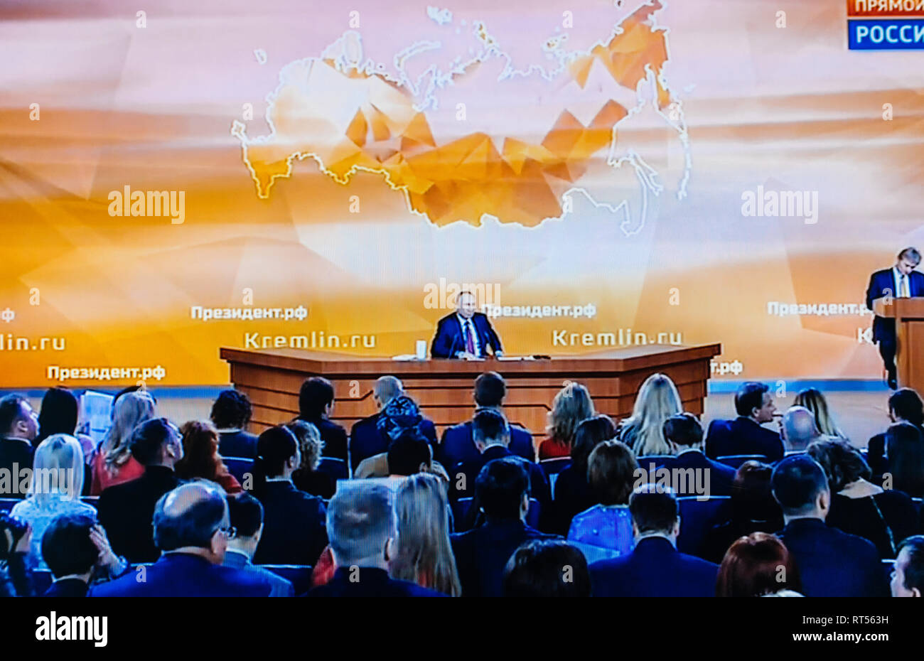 PARIS, FRANCE - DEC 14, 2017: POV watching on Youtube live channel of Rossiya RTR the Russian President Vladimir Putin give final media Q&A before March election large hall with journalists - Stock Image