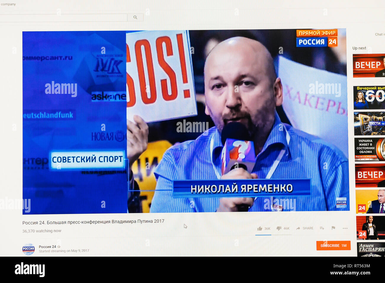 PARIS, FRANCE - DEC 14, 2017: Nikolai Yaremenko from Soviet Sport magazine poses question to Russian President Vladimir Putin give final media Q&A before March election - Stock Image