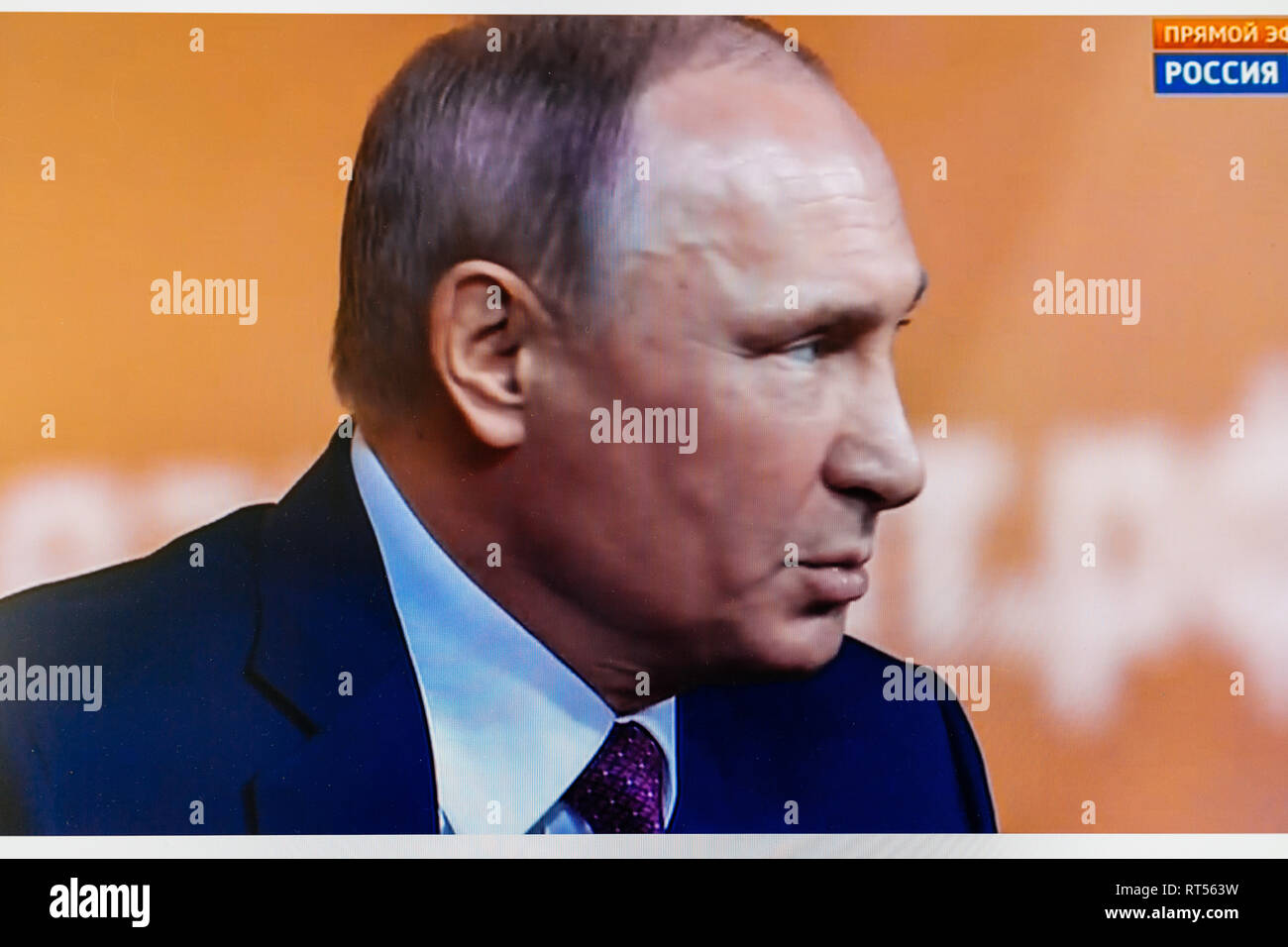 PARIS, FRANCE - DEC 14, 2017: POV watching on Youtube live channel of Rossiya RTR the Russian President Vladimir Putin give final media Q&A before March election - face portrait close-up - Stock Image