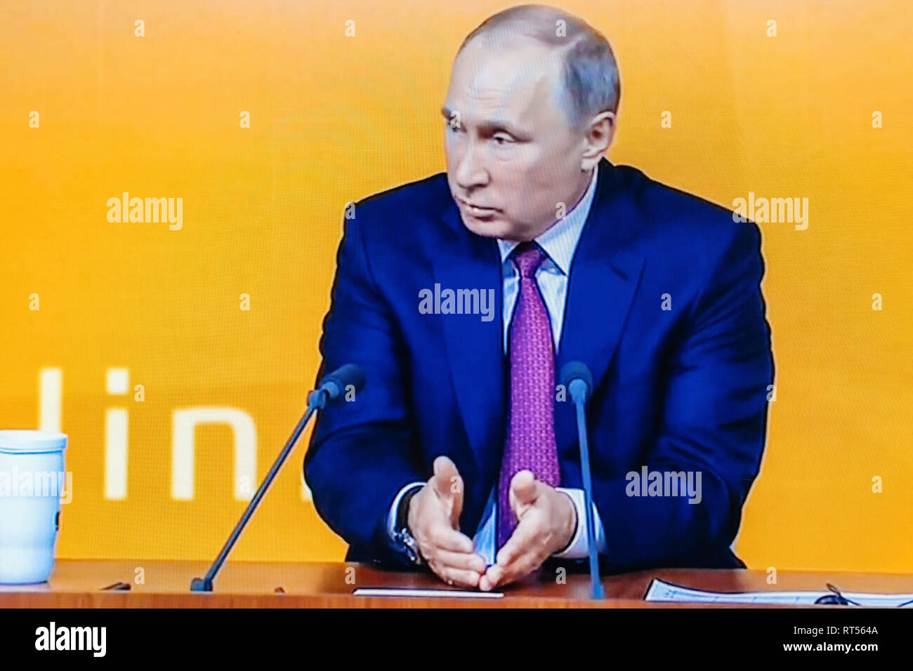 PARIS, FRANCE - DEC 14, 2017: Watching Youtube live channel of Rossiya RTR the Russian President Vladimir Putin give final media Q&A before March election - Stock Image