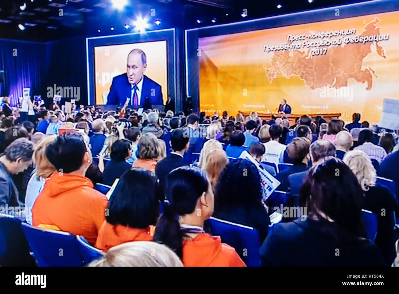 PARIS, FRANCE - DEC 14, 2017: POV watching on Youtube live channel of Rossiya RTR the Russian President Vladimir Putin give final media Q&A before March election - large hall with media journalists - Stock Image