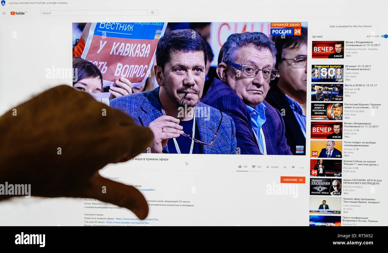 PARIS, FRANCE - DEC 14, 2017: Man thumb down for the Russian President - watching on Youtube live channel of Rossiya RTR the Russian President Vladimir Putin give final media Q&A before March election - Stock Image