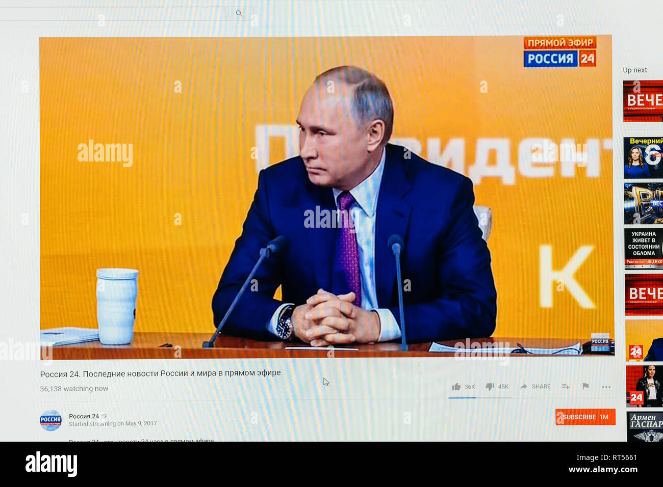 PARIS, FRANCE - DEC 14, 2017: Watching on Youtube live channel of Rossiya RTR as the Russian President Vladimir Putin give final media Q&A before March election - Stock Image