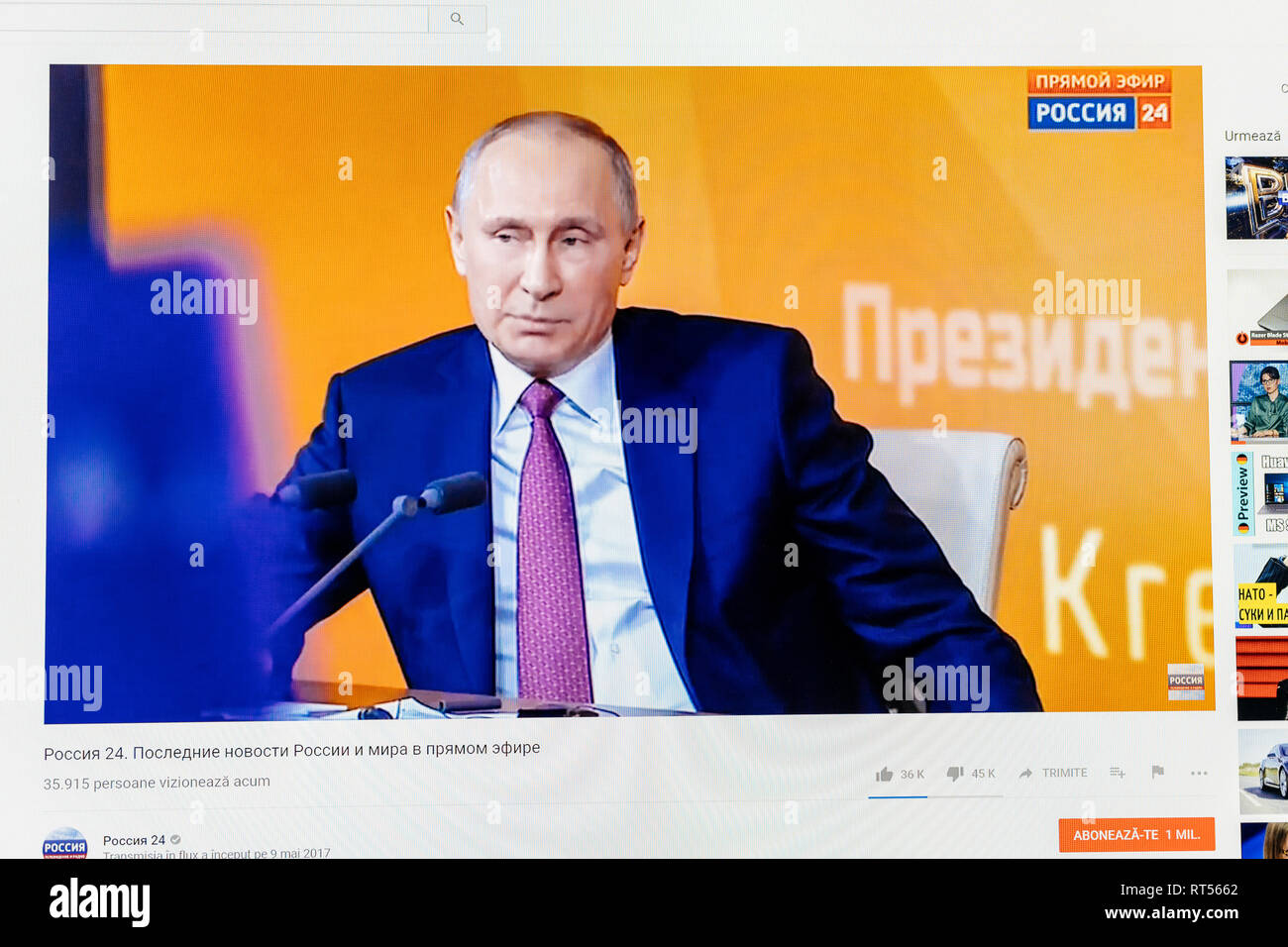 PARIS, FRANCE - DEC 14, 2017: Watching Youtube live channel of Rossiya RTR with relaxed pose of Russian President Vladimir Putin as he gives give final media Q&A before March election - Stock Image