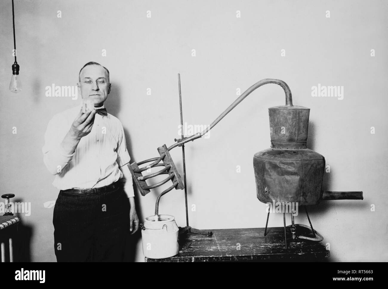 American history photograph showing a confiscated moonshine still. - Stock Image