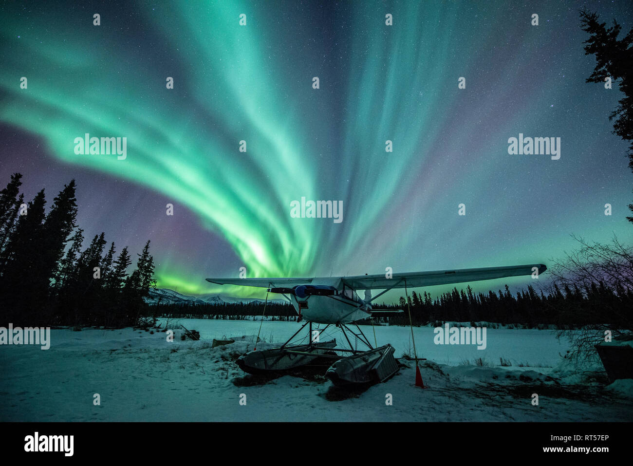 Northern lights above a plane at night, Whitehorse, Yukon, Canada