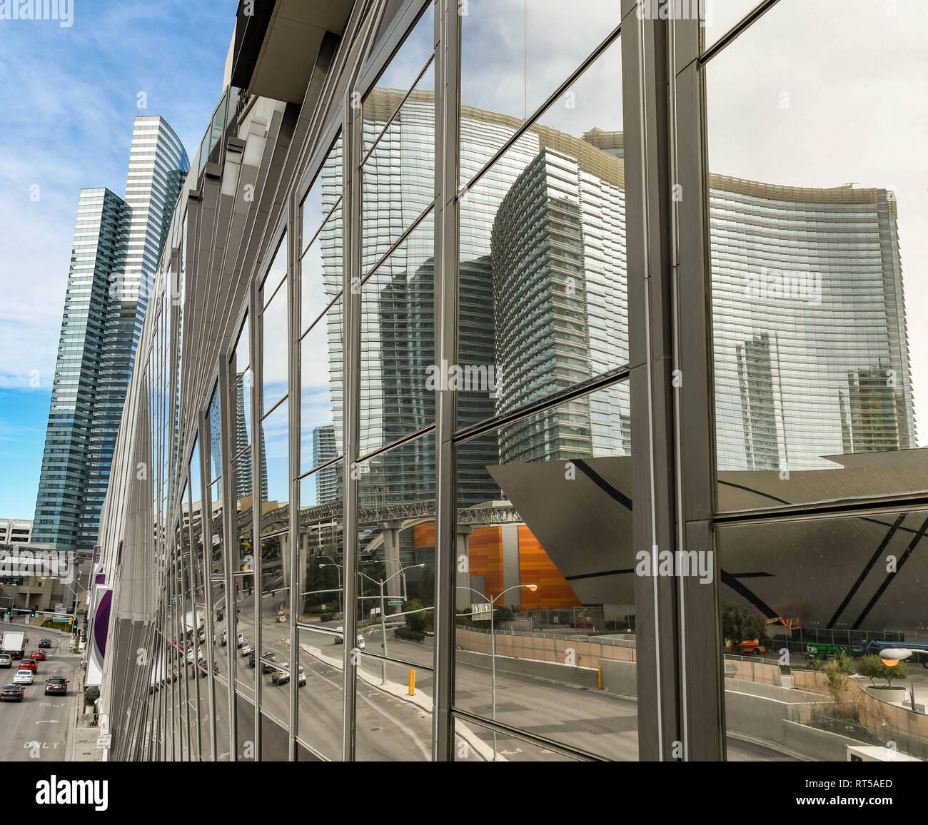 LAS VEGAS, NEVADA, USA - FEBRUARY 2019: The building of the Aria hotel reflected in large panels of glass on another building on Las Vegas Boulevard,  - Stock Image